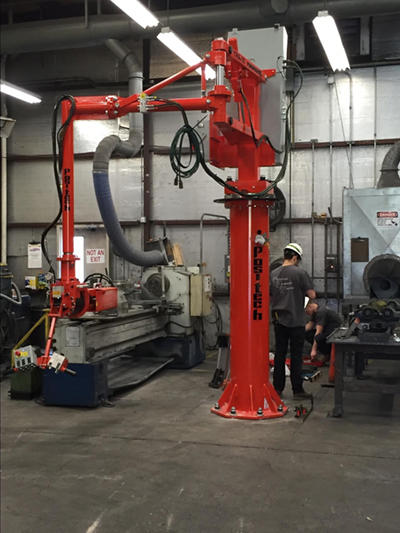 Industrial Equipment Erectors installing an industrial manipulator crane for manufacturer